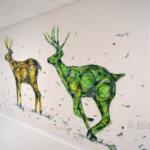 Fresque de trois cerfs qui court
